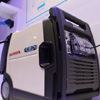 "Honda Motor Co., Ltd. displays a portable inverter box that makes ""traveling power plants"" a reality"